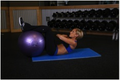 Crunches with legs on ball photo credit: bodybuilding.com